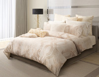 Mirasol Bedding Collection in beige with gold pattern in a modern bedroom