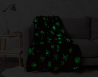 Snowfall Glow in the Dark Throw pictured in the dark with glow in the dark portions lit up.