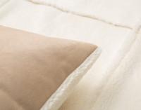Close up of seam on Windowpane Shearling Pillow Sham.