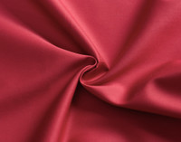 Close up of Cotton Rich Sheet Set in Cherry Red.