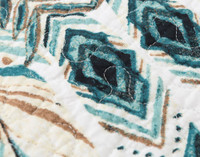 Close up of feather print on Mantra Cotton Quilt Set.