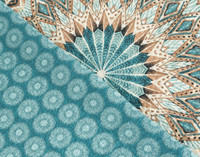 Close up of medallion print and reverse circle print of the Mantra Cotton Quilt Set.