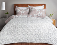 The Amaryllis Coverlet Set reverses to a light grey leave pattern on a white background.
