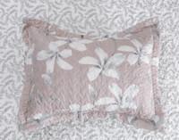 The Amaryllis Pillowsham features a white amaryllis flower, botanical print on a blush pink background.