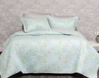 The Rivulet Coverlet Set features a yellow botanical print on a mint green background.