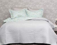 The Rivulet Coverlet Set reverses to a light grey.
