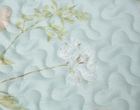 Close up of botanical print on Rivulet Coverlet Set.