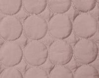 Circular sewing detail of the Ringo Coverlet Set in Woodrose.