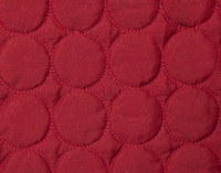 Circular sewing detail of Ringo Coverlet set in Ruby red.