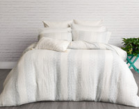 Mimeo Bedding Collection features a white background punctuated with variegated sky blue stripes