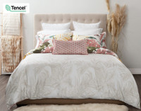 Mahana Duvet Cover reverses to the subtle tropical palm frond pattern on a white background.