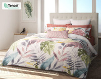 Mahana Duvet Cover features oversized tropical leaves in shades of teal, gold, terracotta and charcoal on a white background to transform your bedroom into an island sanctuary.