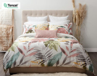Mahana Bedding Collection features oversized tropical leaves in shades of teal, gold, terracotta and charcoal on a white background to transform your bedroom into an island sanctuary.