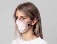 100% Silk Reusable Face Mask in Blush Pink features adjustable ear straps to fit any face shape.