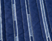 Close up of print on Hockey Sticks Cotton Quilt Set.