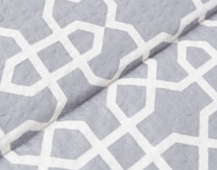 Close up of interlinked white geometric pattern.