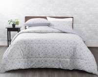 Brockwell Comforter Set features an interlinked white geometric pattern on a soft grey dimpled background.