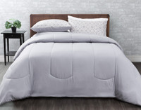 Brockwell Comforter Set reverses to a solid light grey.