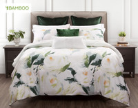 Rosanna Duvet Cover features  oversized white roses dotted with gold centers, surrounded by green and aqua blue foliage.
