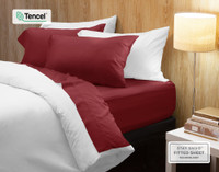 BeechBliss TENCEL™ Modal Sheet set in Garnet, a rich red.