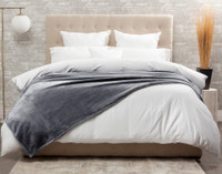 The Cashmere Touch Fleece Blanket pictured in Sleet, a smoky grey.