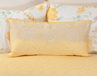 Alyssa Boudoir Cushion Cover features white floral embroidery and a tone-on-tone leaf pattern against a yellow backdrop.