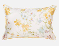 Alyssa Pillow Sham features wild yellow dahlias and daisies and yellow piping.