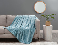Fringe Velour Throw in Tidewater, a soft blue.
