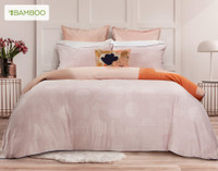 Memphis Duvet Cover reverses to a coordinating blush tone-on-tone small circle print in bamboo blend sateen fabric.