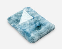 Frosted Shaggy Throw in Ocean, folded angle view.