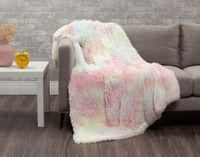 Our Frosted Shaggy Throw in Rainbow features a tie-dye print in shades of pink, blue, and yellow