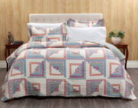 The Cassie Coverlet Set features cubes in shades of orange, pink, purple, blue, and green creating diamond shapes on an off-white background.