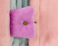 Close up of button snap closure