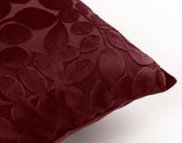 Close up of Velvet Vine Square Cushion in Garnet, a dark red.