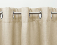 Hanging on curtain rod, side view.