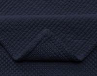 Close up of seam on quilt.