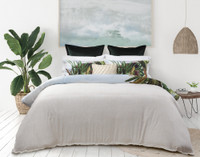 Belize Duvet Cover reverses to a subtle sandy beige printed woven pattern on bamboo blend sateen fabric.