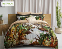 Belize Duvet Cover features rainforest greens, browns and pale blues