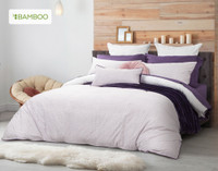 Esprit Duvet Cover reverses to a light pink and purple link print.
