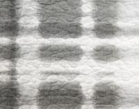 Close up of Shibori tie-dye effect in dark grey