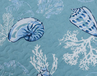 Close up of seashell and coral print.