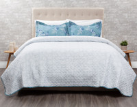 Shells Coverlet Set reverses to a soft blue-grey white white coral detailing