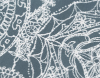 Reverse of Sonesta Duvet cover and shams features a blue background with white medallions