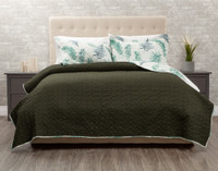 Forest Fern Coverlet reverses to a solid deep forest green