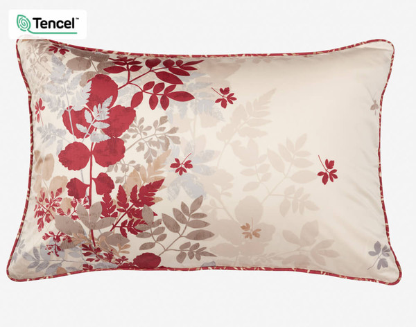 Aubrey Pillow Sham features a soft scattering of leaves in neutral tones, highlighted with accents of deep red.