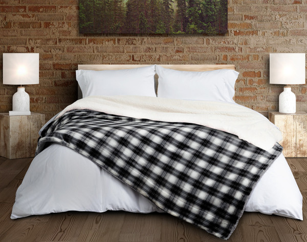 Plaid Sherpa Blanket in Charcoal on Bed