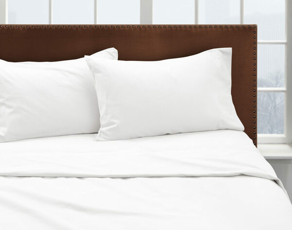Our White Flannel Sheet Set dressed over a bed and pair of pillows.