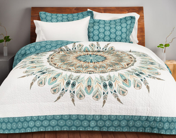 The Mantra Cotton Quilt Set, featuring a contemporary medallion pattern in teal and brown on a white background with a matching teal border.