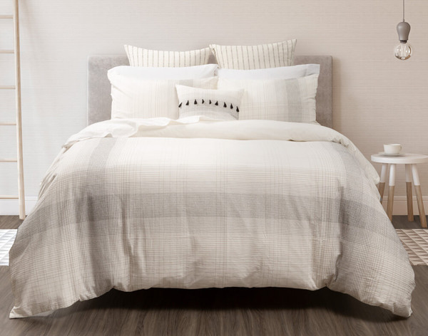 Mitchell Bedding Collection features oversized plaid jacquard with raised stitching lines in black, grey, and taupe on a natural white backing fabric.