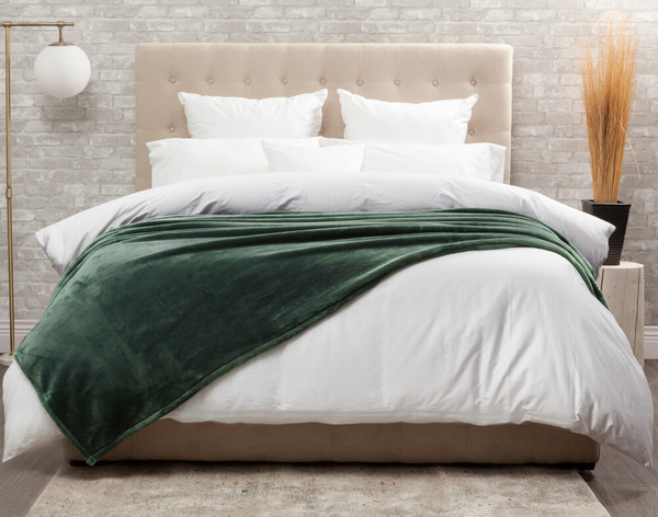 The Cashmere Touch Fleece Blanket pictured in Rainforest, a rich jade green.